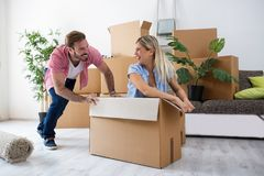 Satisfaction of the young couple at new apartment. Satisfaction of the young couple after buying a new home Stock Image