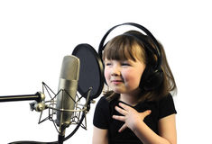 Satisfied. Little girl satisfied with her song recording Royalty Free Stock Photography