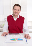 Satisfied accountant working with graphs. Stock Image