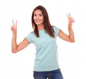 Satisfied adult lady celebrating her victory Royalty Free Stock Photography