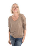 Satisfied attractive middle aged isolated smiling blond woman. Satisfied attractive woman in forties smiling over white background stock photography