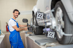 Satisfied auto mechanic working with sensor Stock Photos