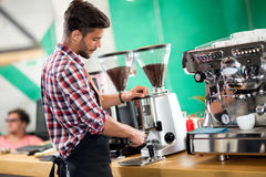 Satisfied barista steaming milk Royalty Free Stock Image