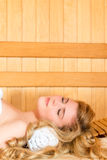 Satisfied beautiful girl relaxes in sauna Stock Images