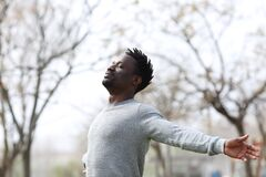 Free Satisfied Black Man Breathing Fresh Air In The Park Royalty Free Stock Images - 189520879