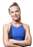 Satisfied Blue eyed blond girl. With tail hair in sportswear with crossed arms and front standing on white isolated background Stock Photo