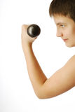Satisfied boy with dumbbell Royalty Free Stock Images