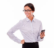 Satisfied brunette businesswoman with cell phone Stock Photo