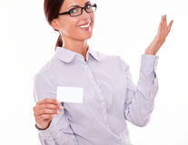 Satisfied brunette businesswoman with visit card Stock Photos