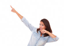 Satisfied brunette pointing up to her right Stock Images