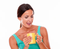 Satisfied brunette woman with coffee mug royalty free stock image
