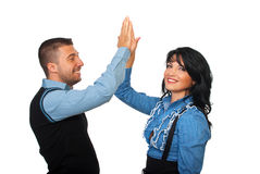 Satisfied business people give high five. Executive businesspeople  give high five and looks satisfied of their business isolated on white background,check also Royalty Free Stock Image