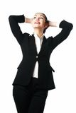 Satisfied business woman with hands behind her hea Stock Photo
