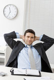 Satisfied businessman Stock Images