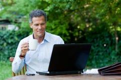 Satisfied businessman Stock Photos