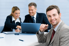 Satisfied businessman with colleagues Stock Photos