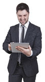 Satisfied businessman holding tablet Royalty Free Stock Image