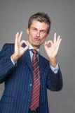 Satisfied businessman. In ok gesture Stock Photo