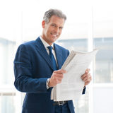 Satisfied businessman read newspaper Royalty Free Stock Images