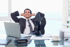Satisfied businessman relaxing Royalty Free Stock Photos