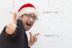 Satisfied businessman wearing Santa Claus hat royalty free stock image