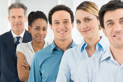 Satisfied Businesspeople Standing In A Row Stock Photo