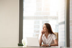 Satisfied businesswoman dreaming about success Stock Images