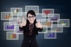 Satisfied businesswoman giving thumbs up Royalty Free Stock Photo