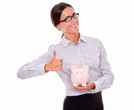 Satisfied businesswoman holding pink piggy bank Stock Images