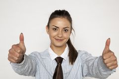 Satisfied businesswoman shows thumbs up Stock Images