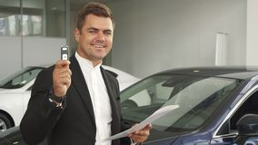A satisfied buyer reads the documents of the car royalty free stock photo