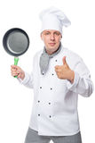 Satisfied chef showing thumbs up and holding a frying pan Stock Photography