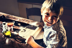 Satisfied child making homemade pizza Royalty Free Stock Image