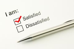 Satisfied choice concept. Consumer satisfaction feed back. Customer service evaluation. Marked checkbox with a pen on. Satisfied choice concept. Consumer stock image