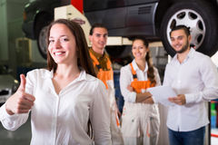 Satisfied client in car service center Stock Images