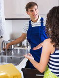Satisfied client thanking professional plumber Royalty Free Stock Image