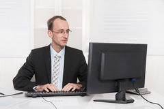 Satisfied conscientious businessman at his office in tie and sui Royalty Free Stock Images