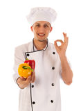 Satisfied cook with fresh paprikas Royalty Free Stock Images