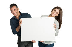 Satisfied Couple Holding White Sign. Mature Couple Looking At Camera With Sign Isolated On White Background Royalty Free Stock Photos