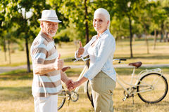 Satisfied couple of mature people that posing on camera Stock Photos