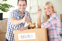 Satisfied couple, savings to new home Royalty Free Stock Photo
