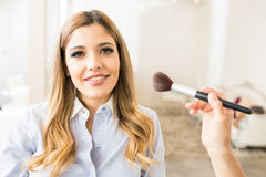 Satisfied customer in a beauty salon. Portrait of a gorgeous young women looking happy and satisfied with her makeup in a beauty salon royalty free stock images