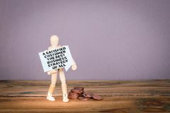 A Satisfied Customer Is The Best Business Strategy of All. Wooden man with speech bubble stock image