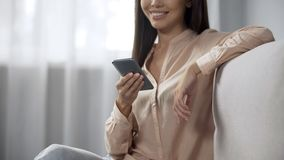 Satisfied customer enjoying online shopping, using phone to purchase products. Stock photo royalty free stock photography