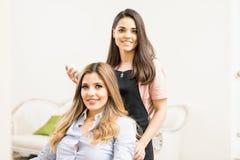 Satisfied customer in a hair salon. Portrait of a happy and satisfied female customer in a hair and beauty salon stock photo