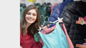 Satisfied customer holding clothes in supermarket stock video footage