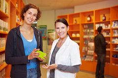 Satisfied customer with pharmacist. Satisfied female customer with pharmacist in a pharmacy Royalty Free Stock Photo