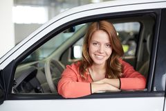 Satisfied customer. Portrait of a charming girl sitting in the car stock photo