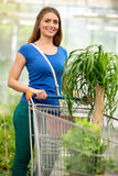 Satisfied customer pushing the trolley in the store glasshouse p Royalty Free Stock Images