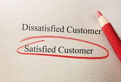 Satisfied Customer survey. Red pencil Satisfied Customer on questionnaire Royalty Free Stock Photos